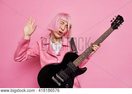 Carefree Female Rocker Sings Song Plays Electric Guitar Has Fun Demonstrates Her Talent Wears Stylis
