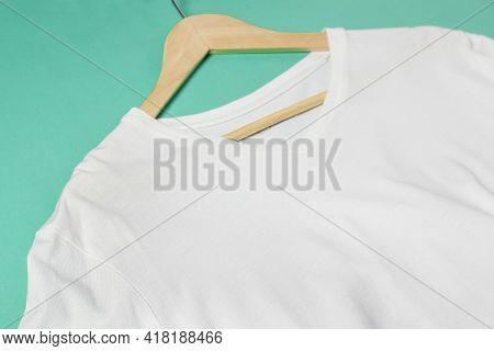 White V Neck T-shirt On Hanger Closeup