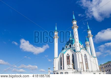 White Building & Minarets Of Kul Sharif Mosque With Turquoise Domes On Blue Sky Background. This Is