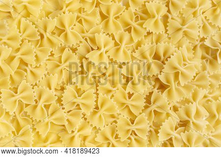Farfalle Bow Tie Wholewheat And Durum Wheat Pasta. Butterflies Shape Uncooked Food Background. Itali