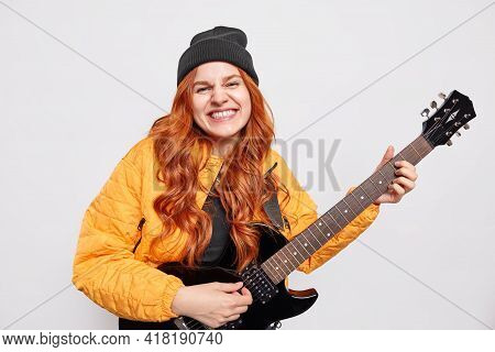 Happy Redhead Female Guitarist Plays Electric Guitar Being In Good Mood Being Famous Rock Musician S