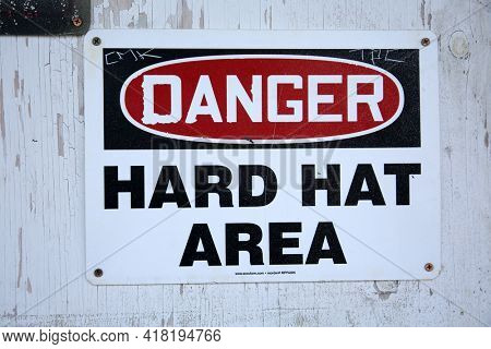 April 18, 2001 Garden Grove, California USA - Hard Hat Sign in the City of Garden Grove California. Construction site with a Hard Hat Required sign on the wall. Editorial Use Only.
