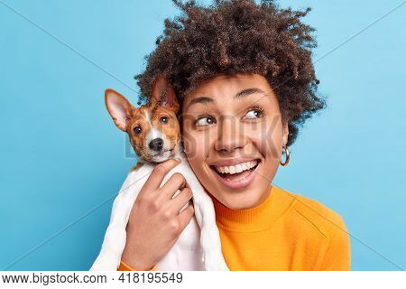 Headshot Of Happy Smiling Dark Skinned Afro American Woman Holds Nice Breed Dog Expresses Positive E