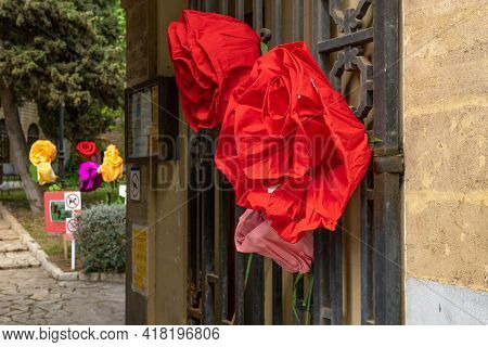 Close-up Of Paper Roses Hung On An Urban Metal Door For The Celebration Of The Day Of The Book Or Sa