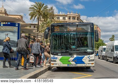 Palma De Mallorca, Spain; April 23 2021: Bus Stop At Plaza España In Palma De Mallorca. Passengers A