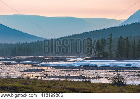 Forest On The Banks Of The River Hoisey. Putorana Plateau, Taimyr, Russia