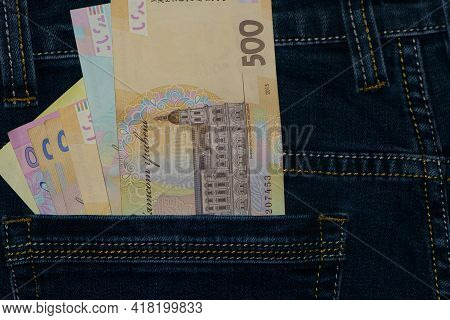 Money In Your Pocket. Ukrainian Hryvnia. 500 Bills In A Pants Pocket. Jeans Trousers, A Lot Of Money