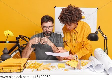 Serious Strict Male Boss Receives Accountings From Colleague Drinks Coffee Looks Angrily At Camera.