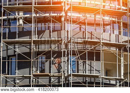 Extensive Scaffolding Providing Platforms For Work In Progress On A New Apartment Block,tall Buildin