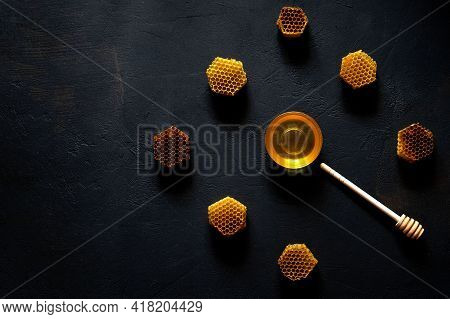 Honey And Honeycomb In The Form Of A Clock On Black Table, Top View.