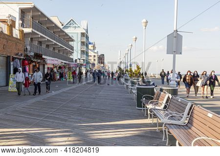04-18-2021 Ocean City Md, Usa: View Of The Famous Board Walk By The Beach Of The Popular Resort Town