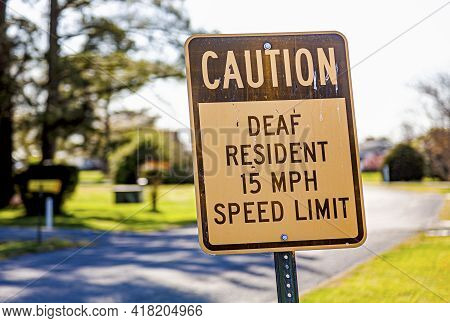 Caution Deaf Resident 15 Mph Speed Limit Traffic Road Sign At A Residential Neighborhood. A Consider