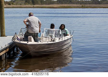 Vienna, Md, 04-16-2021: A Galaxy Model Small Open Motorboat With Three Passengers Is Setting Up For