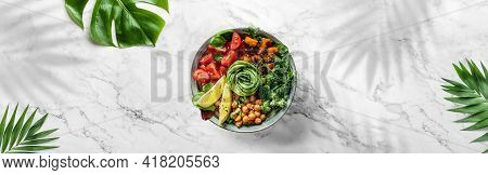 Buddha Bowl Salad With Baked Sweet Potatoes, Chickpeas, Tomatoes, Greens, Avocado On White Marble Ba