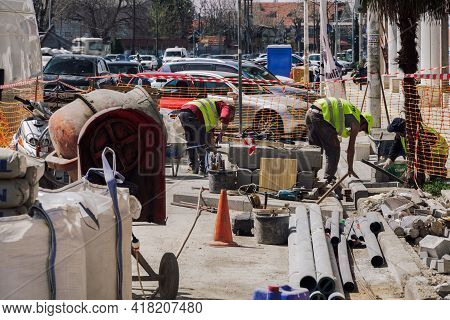 Thessaloniki, Greece - 02 April 2021: Day View Of Manual Labor Workers With Yellow Vest On A Street.