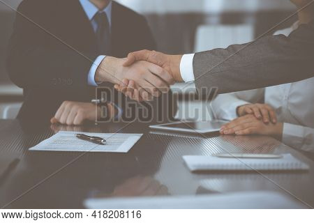 Handshake As Successful Negotiation Ending, Close-up. Unknown Business People Shaking Hands After Co
