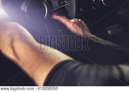 Modern Sporty Car Ignition Start Button. Pressing By Caucasian Driver. Automotive Technology Theme.