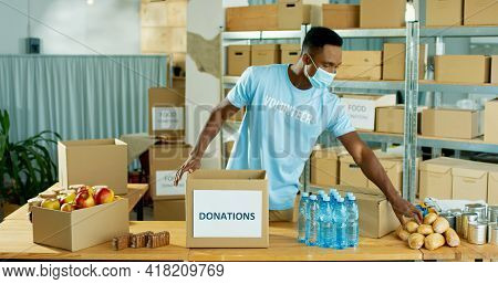 African American Young Handsome Happy Male Warehouse Worker Volunteer Working In Shipping Delivery C