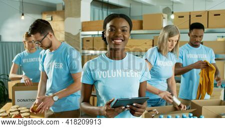 Close Up Portrait Of Happy Joyful Young African American Woman In Good Mood Holding Tablet In Hands