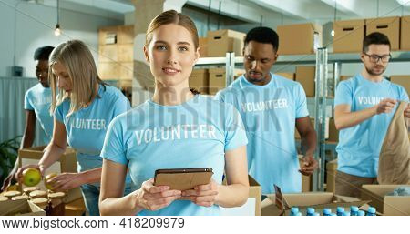 Close Up Portrait Of Caucasian Beautiful Cheerful Young Female Volunteer In Good Mood Working In Cha