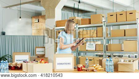 Portrait Of Busy Senior Caucasian Beautiful Woman Volunteer Working In Charity Center Warehouse Unpa