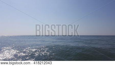 Beautiful Blue Sky Over Calm Sea With Sunlight Reflection, Tranquil Sea Harmony Of Calm Water Surfac
