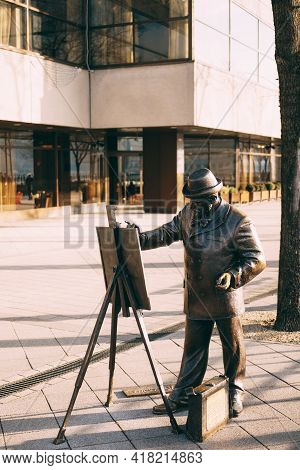 Monument To The Artist With Easel In Budapest. Monument To Ignatius Roshkovich.