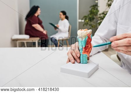 Thyroid Gland Check-up. Doctor Examining Overweight Womans Enlarged Thyroid, Tumor Thyroid