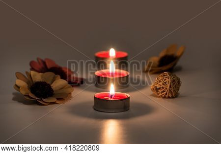 Burning Fire Of Candles On S Table. Blurred Reflection And Selective Focus Of Glowing Candle Flames