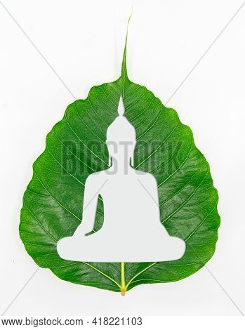 Isolated Beautiful Silhouette Buddha Statue Shape Of Sitting On A Fresh Green Leaf Or Pho Leaf (bo L