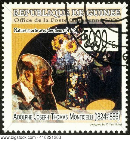 Moscow, Russia - April 23, 2021: Stamp Printed In Guinea Shows Adolphe Monticelli And His Picture St