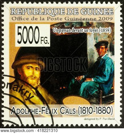 Moscow, Russia - April 24, 2021: Stamp Printed In Guinea Shows Adolphe-felix Cals And His Painting P