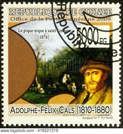 Moscow, Russia - April 24, 2021: Stamp Printed In Guinea Shows Artist Adolphe-felix Cals And His Pai