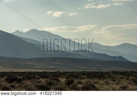 Hazy Layers Behind Desert Valley In Afternoon Light In Great Basin National Park