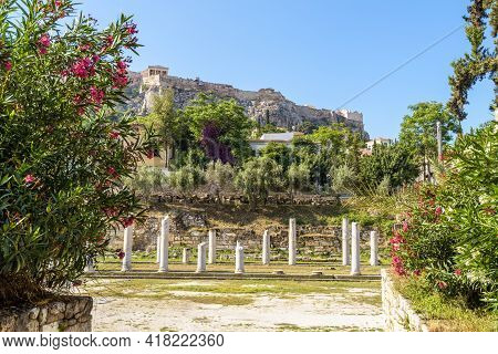 Roman Agora In Athens, Greece, Europe. Famous Acropolis In Distance. Scenic View Of Ancient Greek Ru