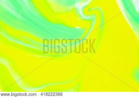 Blurred Bright Abstract Background Of Yellow, Green And White Color With Fluid Smooth Lines