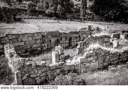 Ancient Greek Ruins In Old Agora, Athens, Greece. Landscape With Remains Of Old Buildings In Summer.