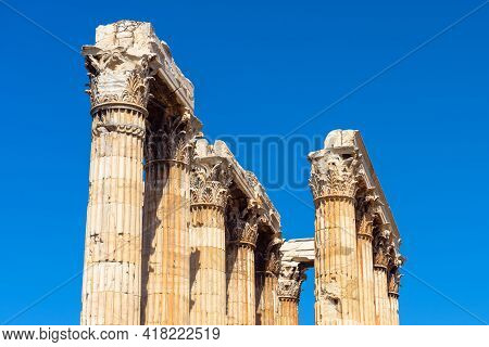 Temple Of Olympian Zeus, Athens, Greece. Classical Corinthian Columns On Blue Sky Background. Ancien