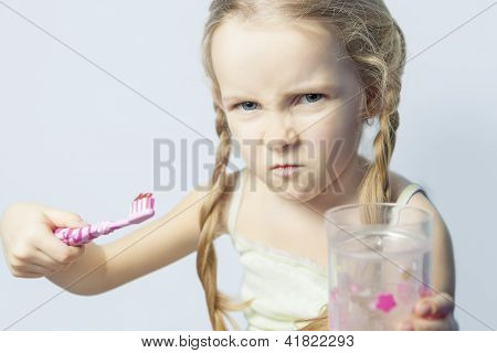 Angry And Furiuos Little Girl Not Willing To Brush Her Teeth