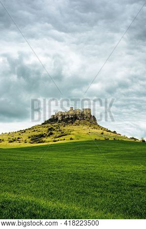 Spis, Slovakia - 29 Apr 2019: Castle Ruins On The Hill. Grassy Meadow In The Foreground. Popular Tra