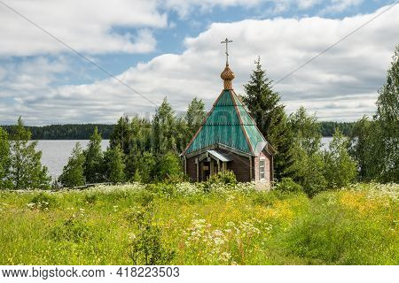 Small Wooden Chapel By The Lake. Vazheozersky Transfiguration Monastery, Karelia, Russia