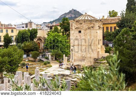 Athens - May 6, 2018: People Visit Tower Of Winds In Roman Agora, Tourist Attraction Of Athens, Gree