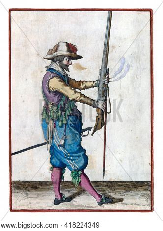 A soldier, full-length, to the right, holding a musket (a certain type of firearm) in front of him with both hands, pointing the barrel upwards, to bring it to his left