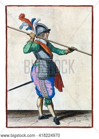 A soldier, full-length, to the right, carrying a spear almost horizontally above his right shoulder. His hands wide apart on the skewer