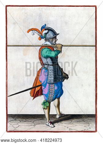 A soldier, full-length, to the right, carrying a spear (lance) horizontally on his right shoulder. His right hand on the skewer. This is the third act of lifting the skewer to the shoulder