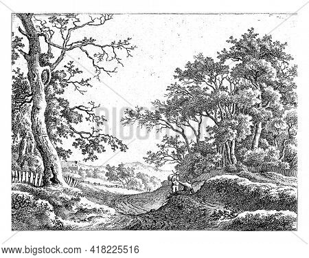 Hilly landscape with two figures along a road.
