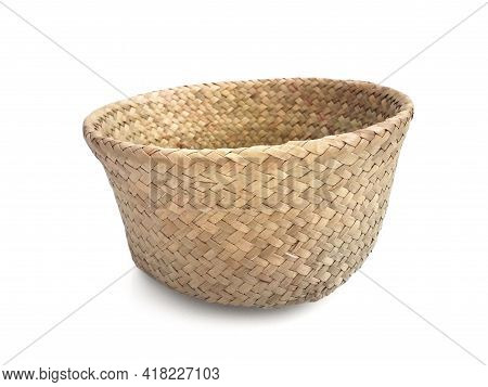 Braided Storage Basket Isolated. Close Up Of Old Plaited Empty Round Wicker Basket. Natural Fiber Ba
