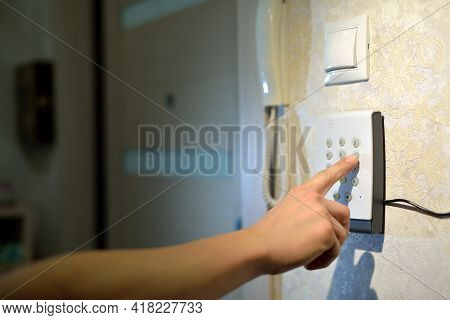 Mans Hand Dials The Code From The Security System At Home On A Keypad With Numbers From Theft And Bu