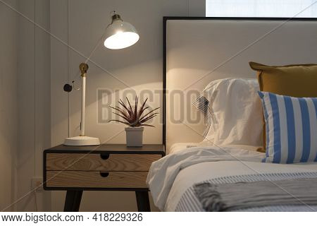 Side Table Lamp In White, Yellow And Blue Cozy Bedroom.