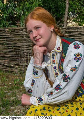 Salaj, Transylvania, Romania-may 14, 2018: Beautiful  Young Girl With Red Hair And Blue Eyes In Trad